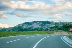 A winding asphalt road is located near Zabljak Royalty Free Stock Images