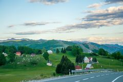 A winding asphalt road is located near Zabljak Royalty Free Stock Photos