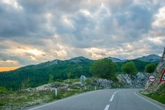 A winding asphalt road is located near Zabljak Stock Images