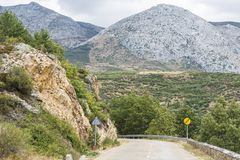 Winding asphalt road in Spain stock photo