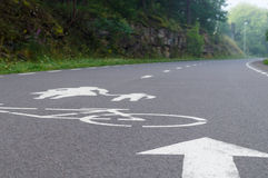 Winding bike and pedestrian pathway with sign on asphalt Stock Photos