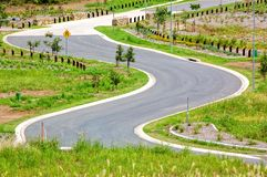 The winding bitumen road. A brand new winding bitumen road found in a recently opened up new development of a residential area royalty free stock photo