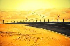Free Winding Black Asphalt Road Through The Sand Dunes Of Liwa Oasis, United Arab Emirates Stock Images - 58928254