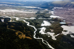 Winding braided river, small lakes, and mountains dominate Alaska landscape Stock Photography