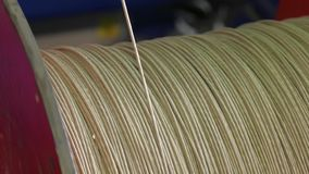 Winding the cable onto the reel. Winding of the electrical cable to the bobbin in the production. Correctly wind the cable on the drum. Industrial cable stock video footage