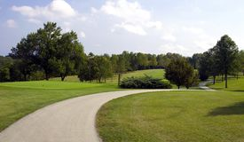 Winding Cart Path. This long winding cart path takes you not only to the next hole but through some scenic Wisconsin landscape Royalty Free Stock Photos