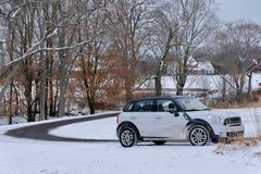 Winding Country Road and Car in Winter. Rural living and motoring in rural Pennsylvania. A Winding country road and car in winter with snow on the ground and royalty free stock photography