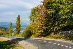 Winding countryside road through mountains. Lovely autumnal scenery Stock Photo