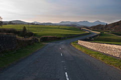 Winding countryside roadway Stock Photography