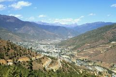Winding or curved asphalt road on the hill with view of Thimphu royalty free stock photography