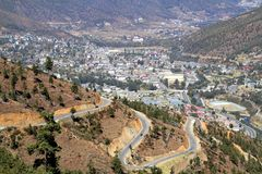 Winding or curved asphalt road on the hill with view of Thimphu stock images