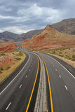 Winding desert highway. And mountains royalty free stock photo