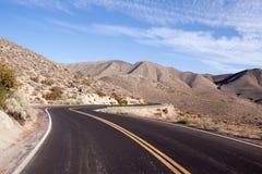 Winding desert highway. Long strecth of winding desert highway Royalty Free Stock Image