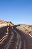 Winding desert highway Royalty Free Stock Image
