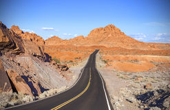 Winding desert highway, travel adventure concept. Royalty Free Stock Image