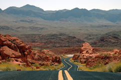 Winding desert mountain highway Stock Images