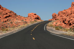 Winding desert road. And red rocks royalty free stock image