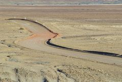 Winding desert road in the Australian Outback near Coober Pedy, Australia. Stock Photos