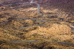 Winding desert road. Winding Palms to Pines Highway desert road in the Coachella Valley, Palm Desert, CA Royalty Free Stock Images