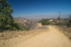 Winding Dirt Mountain Road Stock Photo