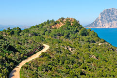 Winding dirt road. On a hill in Capo Cosa Cavallo Royalty Free Stock Photos