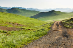Winding dirt road through Central Mongolian steppe Stock Photography