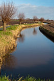 Winding ditch in a Dutch polder landscape Stock Photos