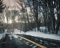 Winding road covered in snow royalty free stock photo