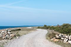 Winding gravel road by the coast Royalty Free Stock Photos