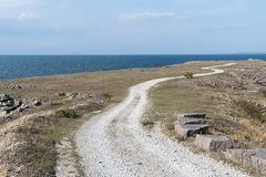 Winding gravel road in a coastal landscape Royalty Free Stock Photo