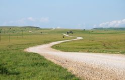 Winding gravel road through mountain meadows at the Pester Plate. Panoramic scenes of the Pester Plateau, karst region in southwestern Serbia. It situated in the royalty free stock photos