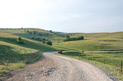 Winding gravel road on the picturesque mountain plateau. Panoramic scenes of the Pester plateau, karst region in southwestern Serbia. It situated in the area of royalty free stock photo