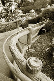 Winding handrail. A handrail leading down a windy path royalty free stock photo