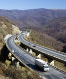 Winding highway. In the mountains stock photos