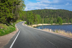 Winding highway along the lake. A winding highway along the lake stock photos