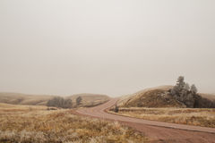 Winding highway in the fog. Winding highway over a hill in the fog Royalty Free Stock Photos