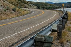 A winding highway through the foothills of the Rocky Mountains in Utah royalty free stock photo