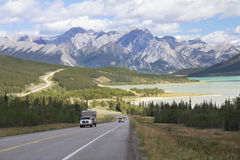 Winding Highway Next to a Mountain Lake - Alberta, Canada. RV on a Winding Highway Next to a Mountain Lake in the Kootenay Plains - Alberta, Canada Stock Photography