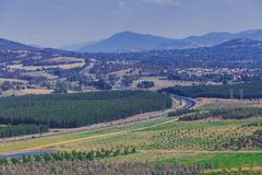 Winding highway passes through mountains. Winding highway passes through mountains and countryside in Canberra, ACT, Australia royalty free stock photos