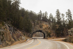 Winding highway through a rock tunnel Royalty Free Stock Images
