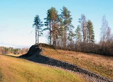 Winding hill along the highway A-121 Sortavala in Karelia. Russia. Autumn. Autumn landscape highway A-121 Sortavala in Karelia. Russia royalty free stock photo