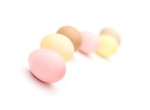 Winding line of multicolored eggs Stock Photos