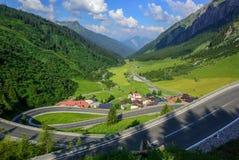 Winding motorway in a beautiful valley, Tyrol, Austria. Motorway road winding down in a beautiful valley in the Alps mountain, Tyrol, Austria, on a bright summer stock photo