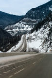 Winding mountain highway in winter Royalty Free Stock Images