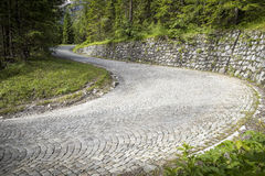 Winding mountain pavement road. In Alps Royalty Free Stock Photos