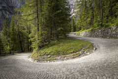 Winding mountain pavement road. In Alps Royalty Free Stock Images