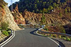 Winding mountain road. A smooth paved road winding through mountains Stock Images