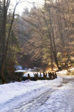 A winding mountain road above the stream Stock Photography
