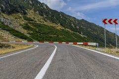 Winding mountain road with dangerous curves in Carpathian mountains. Transfagarasan road in Romania Stock Photo