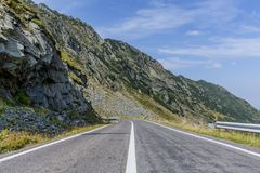 Winding mountain road with dangerous curves in Carpathian mountains. Transfagarasan road in Romania. Romania - Fagaras Mountains in Transilvania. Famous Stock Images